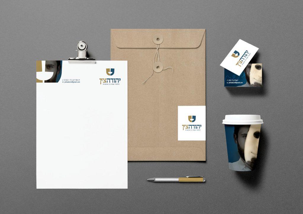 פרסום פיקנטי לקוח יהודה צין עיצוב ניירת מיתוג